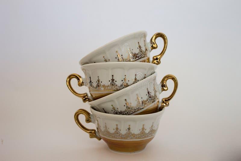 Drei Teecup auf Saucers stockfotos