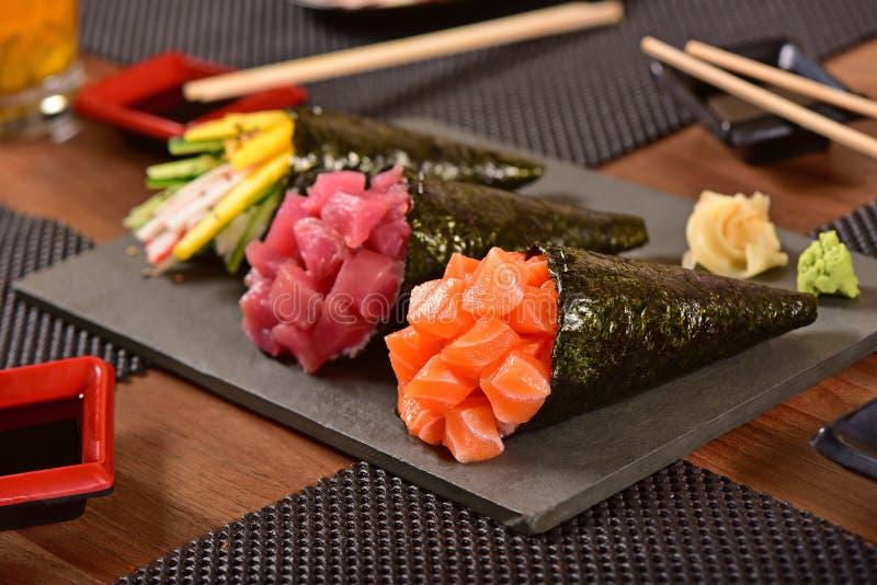 Drei temaki Sushi lizenzfreie stockfotos