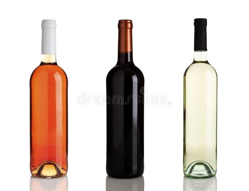 Drei verschiedene Flaschen Wein ohne Kennsätze lizenzfreie stockbilder