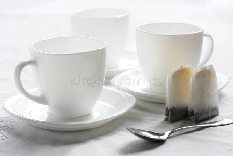 Drei weiße Cup. lizenzfreie stockfotografie