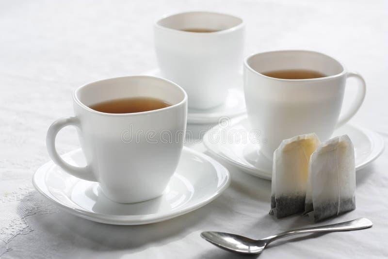 Drei weiße Cup. lizenzfreie stockbilder
