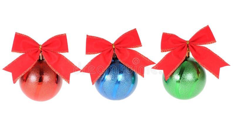 Drei Weihnachtsdekorationen lizenzfreie stockbilder