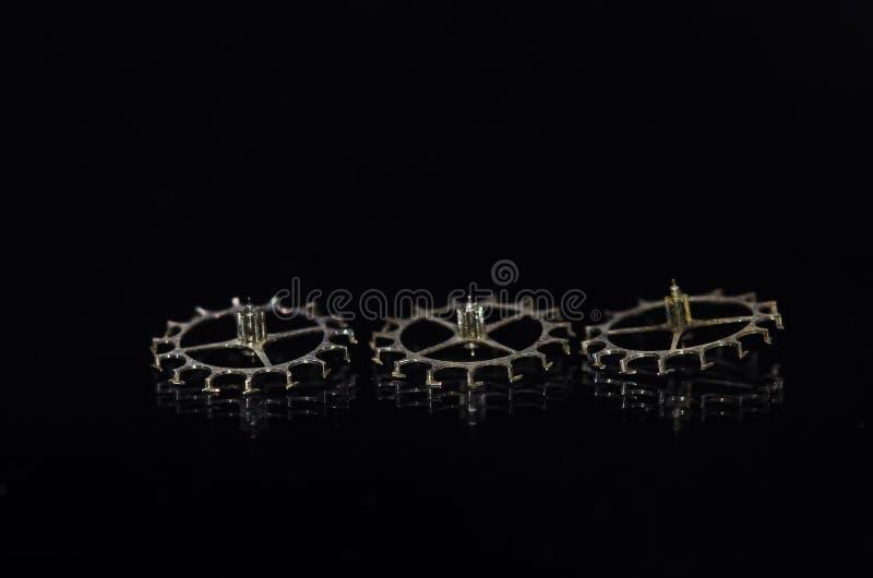 Drei Weinlese-metallisches Entweichen-Rad für Zylinder-Hemmung stockbilder