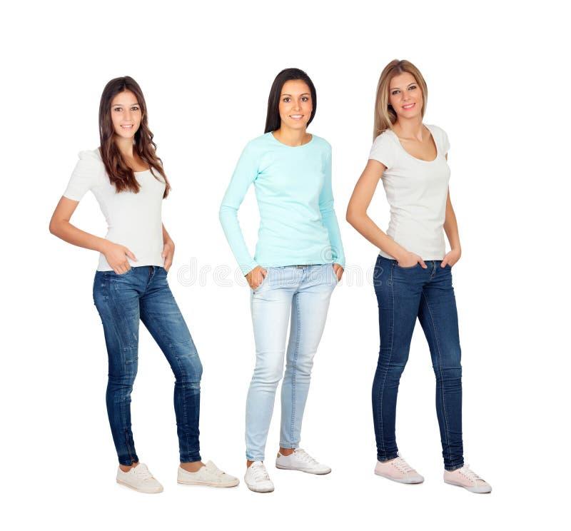 Drei zufällige junge Frauen stockfotos
