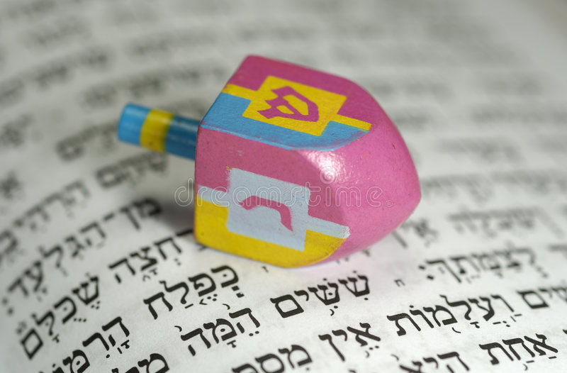 Dreidel. With Gelt and a Hebrew Bible - Passover Related stock photos