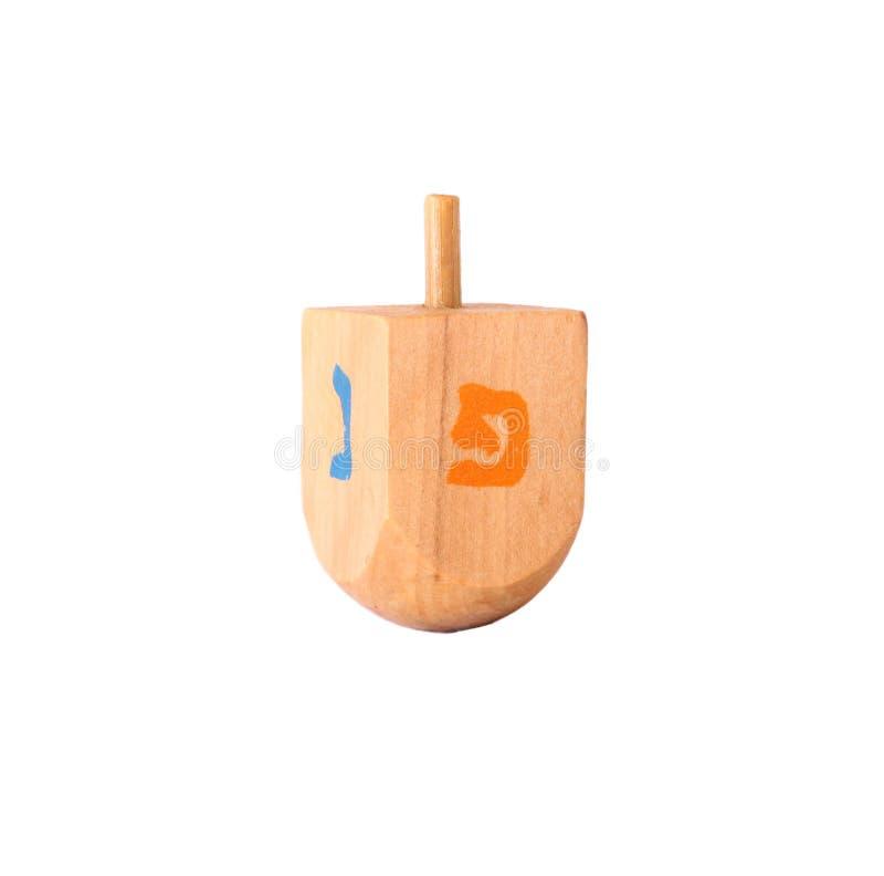 Dreidel de madera (top de giro) para el día de fiesta judío de Jánuca imagenes de archivo