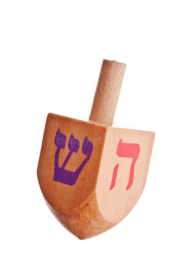 Dreidel di Chanukah su fondo bianco immagine stock