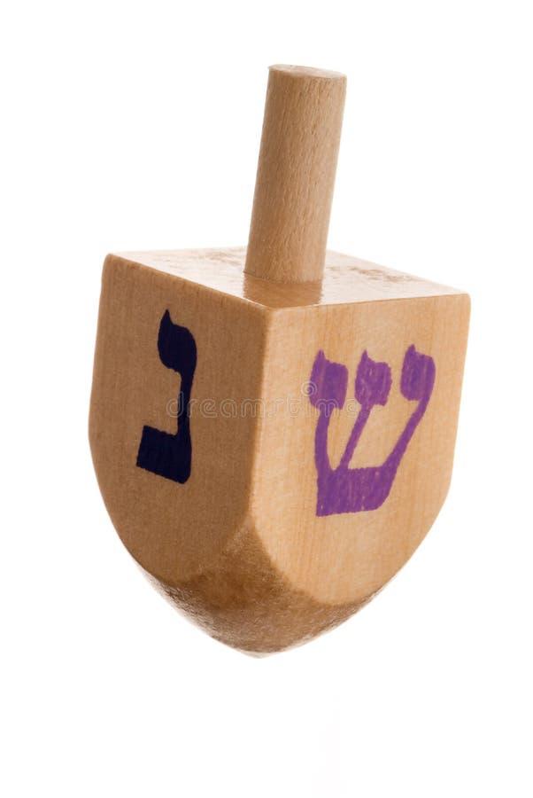 Dreidel di Hanukkah, isolato su priorità bassa bianca. immagine stock