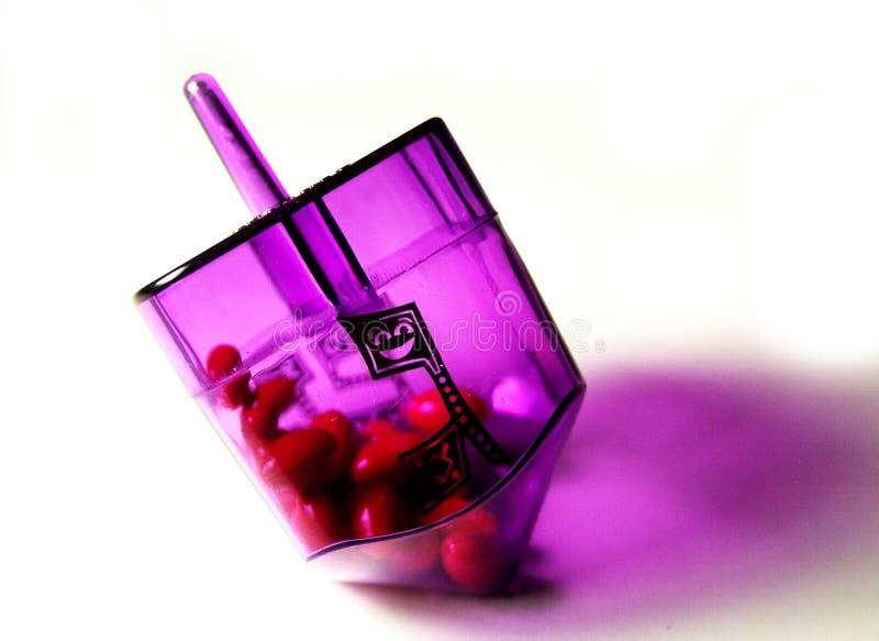 Dreidel púrpura foto de archivo