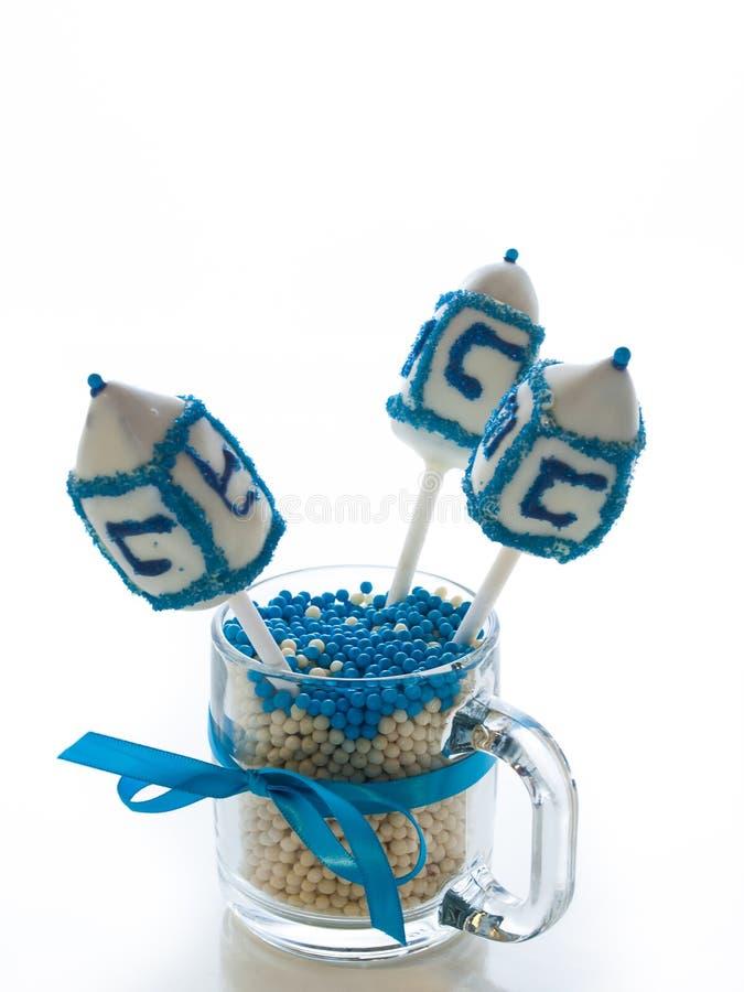 Dreidels. Gourmet dreidels decorated with white icing for Hanukkah stock photos
