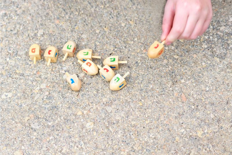 Dreidels For Hanukkah. Wooden dreidels used for playing a game during the Jewish holiday of Chanukah. stock photos