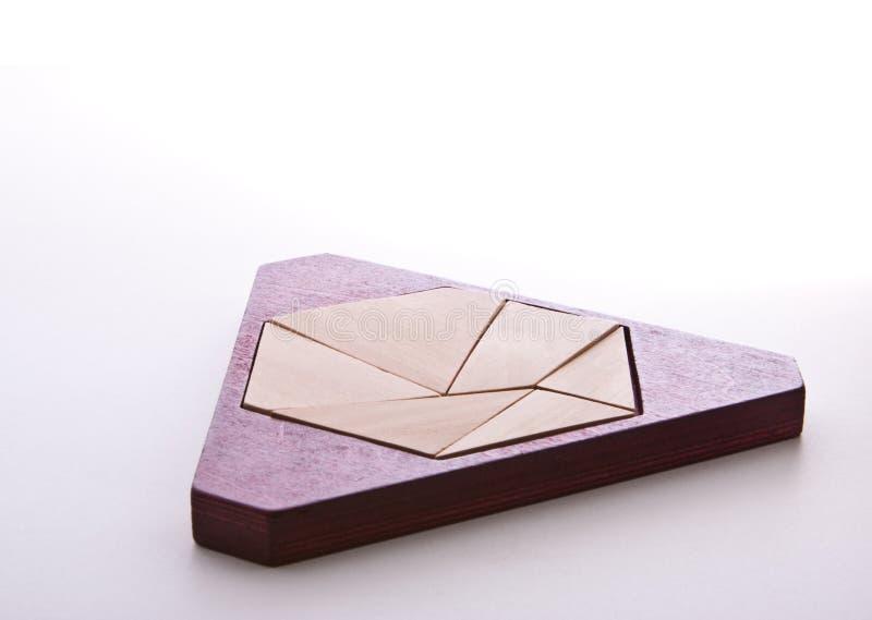 Dreieck-Puzzlespiel lizenzfreie stockbilder