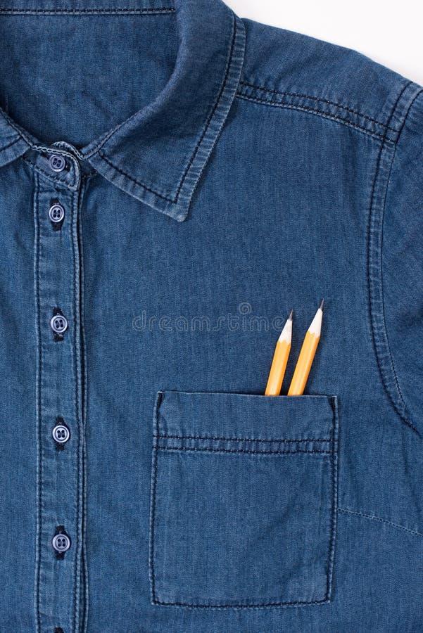 Drelichowa koszula z dwa ołówkami w kieszeni fotografia royalty free