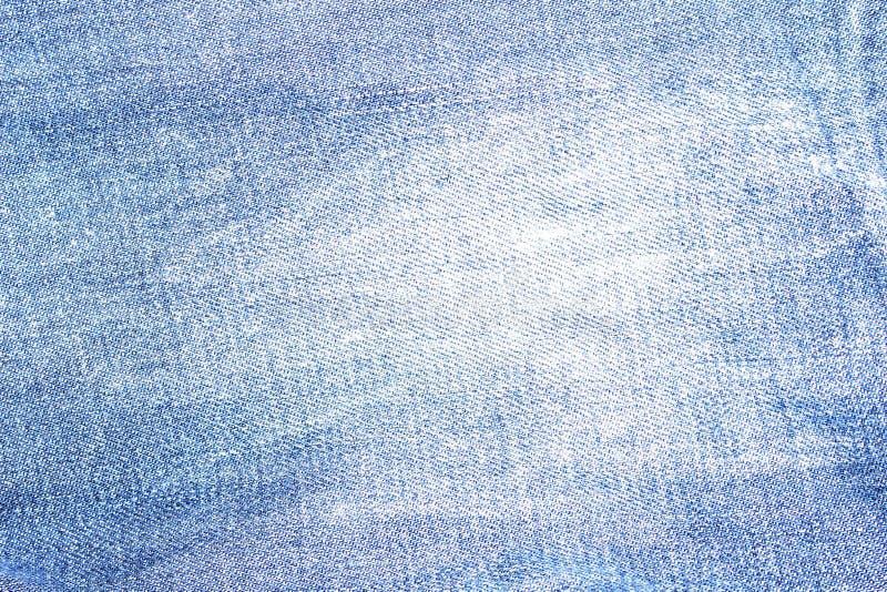 Drelichowy cajg tekstury tło z postrzępioną dziurą obrazy royalty free