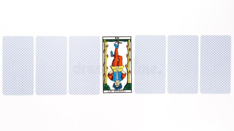 Drenaje colgado carta de tarot fotos de archivo libres de regalías