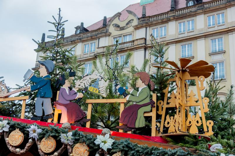 Iew of the Christmas decorations, toys and scenery houses on the Christmas market in Dresden on the square Altmarkt. Dresden, Germany - december 14, 2018: view royalty free stock photo