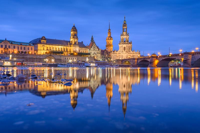 Dresden, Germany on The Elbe River. Dresden, Germany classical cathedrals and spires on The Elbe River at night royalty free stock photos