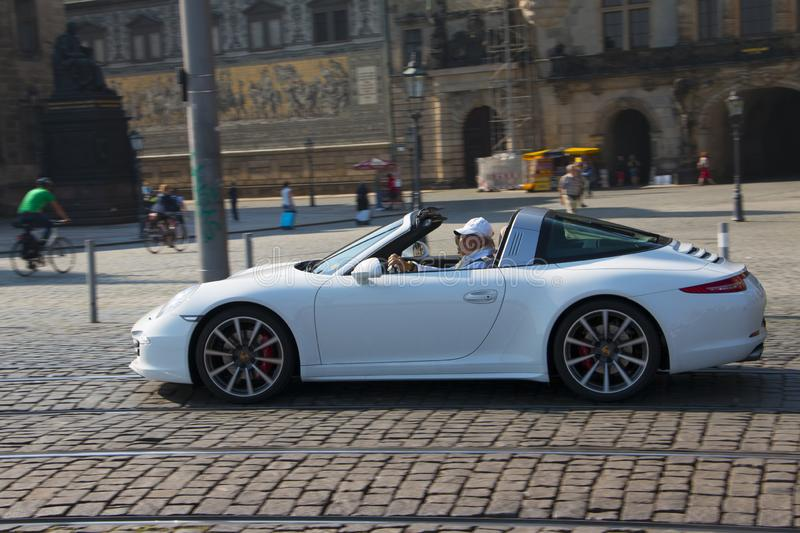 Dresden, Germany - July, 2015: Old man rides his porsche. stock images