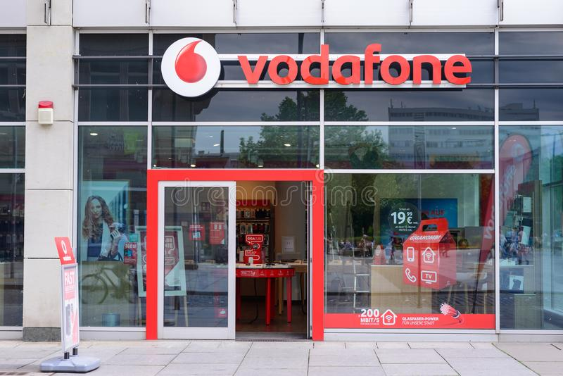DRESDEN, GERMANY - MAY 2017: Vodafone shop sign, company based in the UK. It provides mobile phone, DSL, LTE, cable internet, land. Lines, cable TV and IPTV stock photos