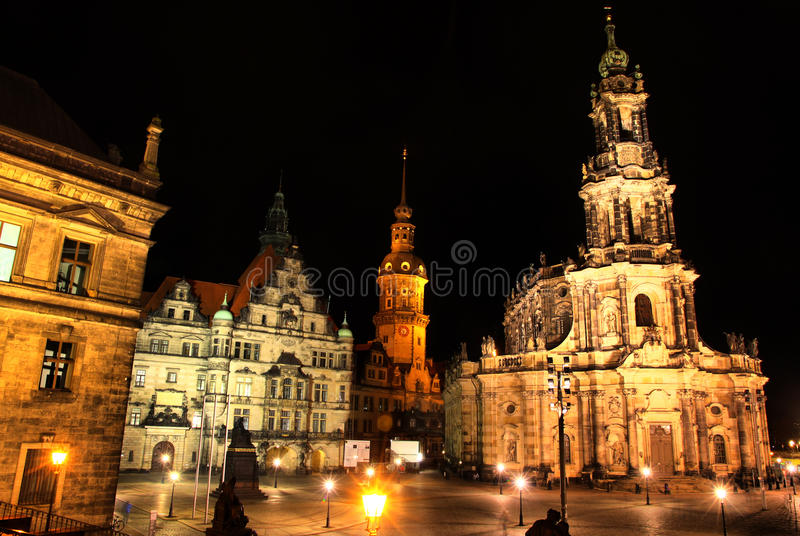 Dresden, Germany at night. View to Schlossplatz and St. Trinitatis Cathedral stock photography