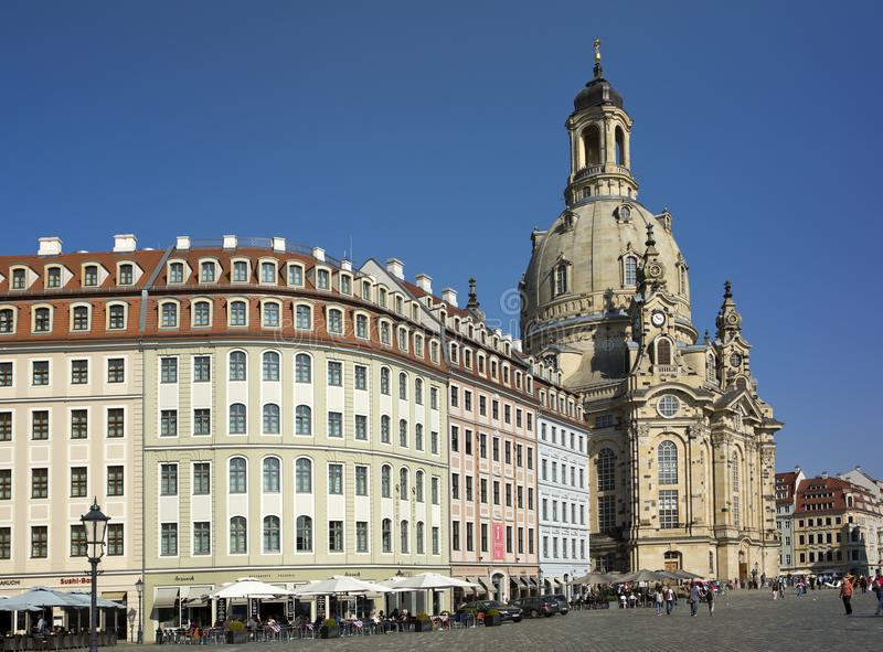 DRESDEN, GERMANY - SEPTEMBER 17, 2014: People walk in the center of Old town, near Frauenkirche Our Lady church stock photo
