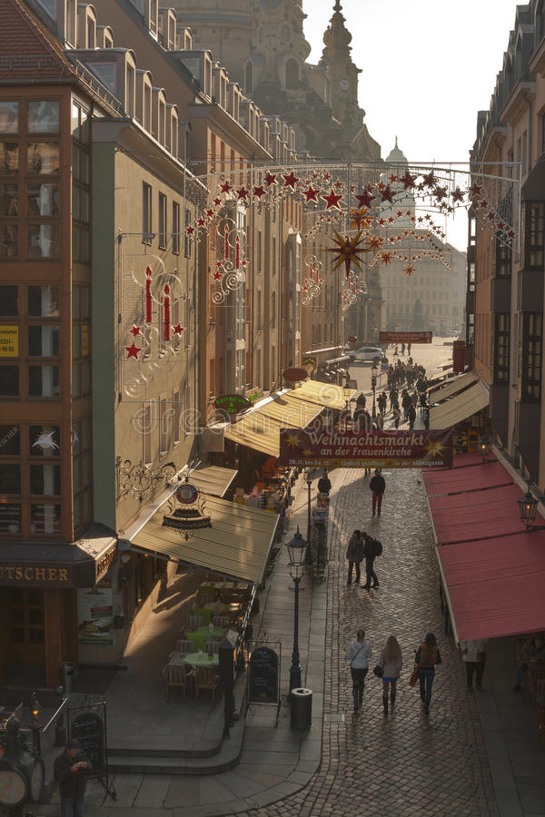 Dresden narrow street with Christmas decorations stock images