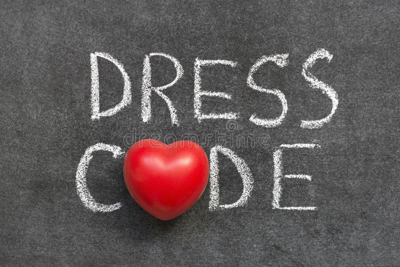 Dress code. Phrase handwritten on blackboard with heart symbol instead of O royalty free stock image
