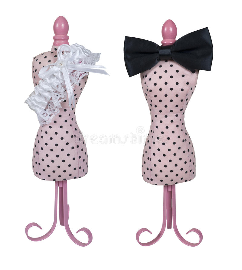 Dress Form with Bow Tie and Garter Belt. Pink dress form used for dressmaking and merchandising with a black bow tie and garter belt stock photography