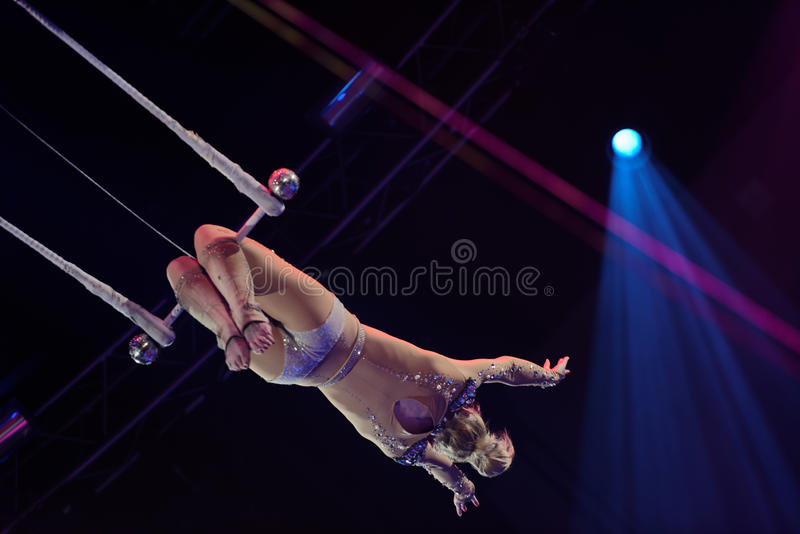 Dress rehearsal in Ciniselli circus, St. Petersburg, Russia. St. Petersburg, Russia - June 2, 2016: Trapeze artist Olga Shmeleva in the dress rehearsal of the stock photo