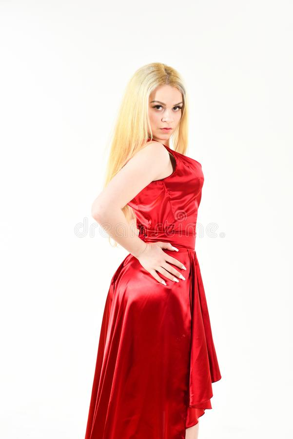 Dress rent service, fashion industry. Girl posing in luxury dress. Woman wears elegant evening red dress, white royalty free stock image