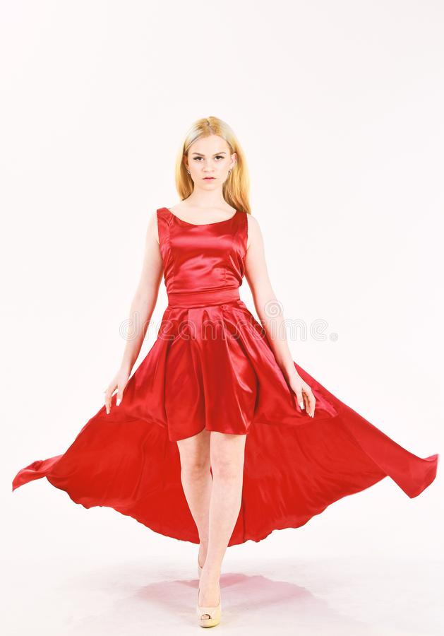 Dress rent service, fashion industry. Woman wears elegant evening red dress, white background. Girl blonde posing in royalty free stock image