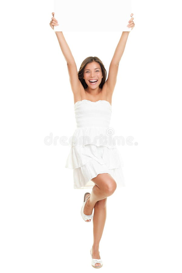 Dress woman holding paper sign. In full body isolated on white background. Cute fresh cheering Caucasian Asian girl holding blank empty paper sign wearing a stock photo