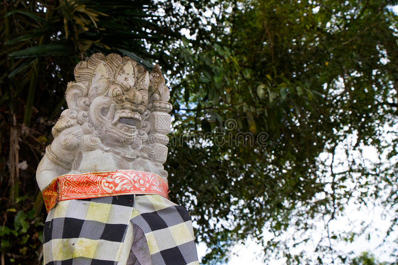 Dressed Balinese Statue in Ubud - Central Bali, Indonesia royalty free stock photo