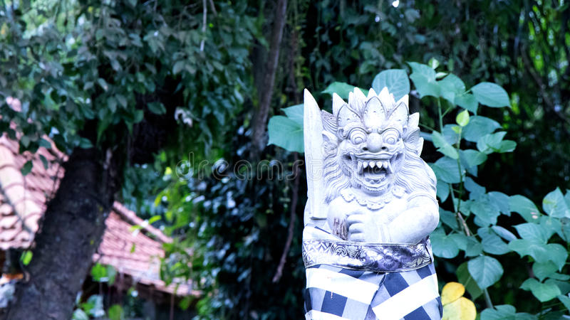 Dressed Balinese Statue in Ubud - Central Bali, Indonesia royalty free stock photography
