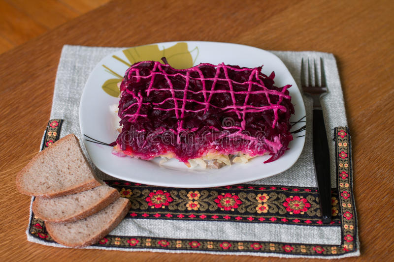 Dressed herring (Ukrainian: Shuba). Is a layered salad composed of diced salted herring covered with layers of grated boiled vegetables (potatoes, carrots, beet stock photo