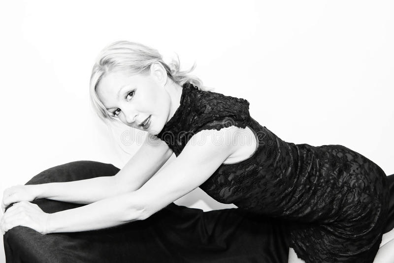 Dressed up blonde on sofa royalty free stock image