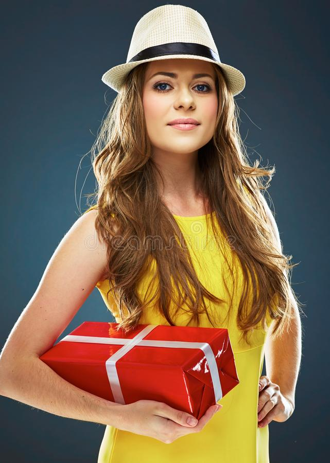 Dressed in a yellow dress young woman standing against gray stu royalty free stock image