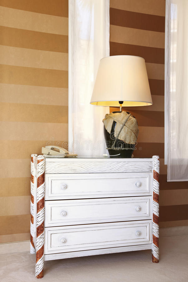 Dresser and table lamp stock image
