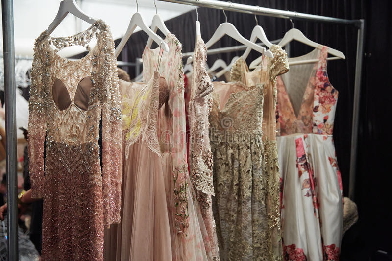 Dresses on hangers backstage at the New York Life fashion show during MBFW Fall 2015. NEW YORK, NY - FEBRUARY 19: Dresses on hangers backstage at the New York stock image