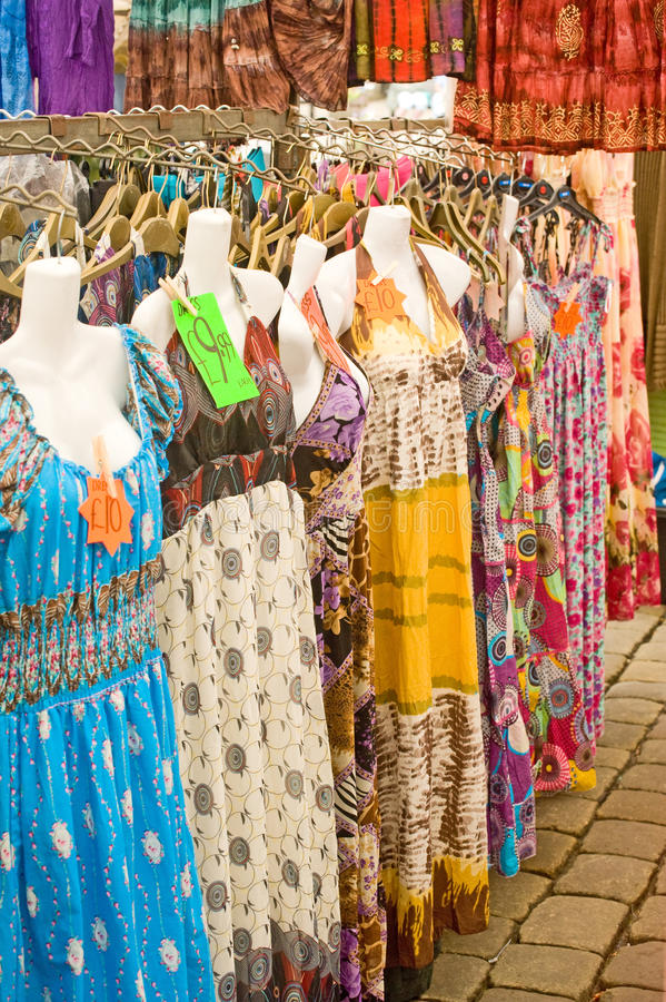 Dresses on market stall. royalty free stock images