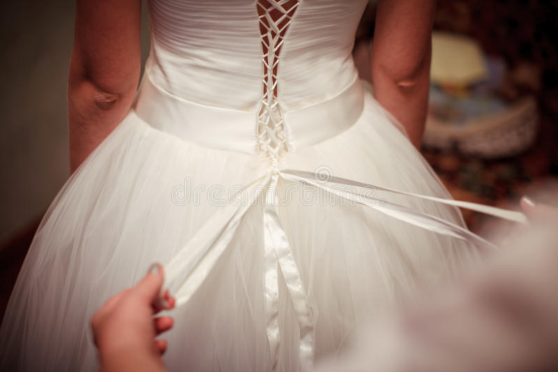 Dressing the bride dresses. Many hands holding on to each other in a group royalty free stock image