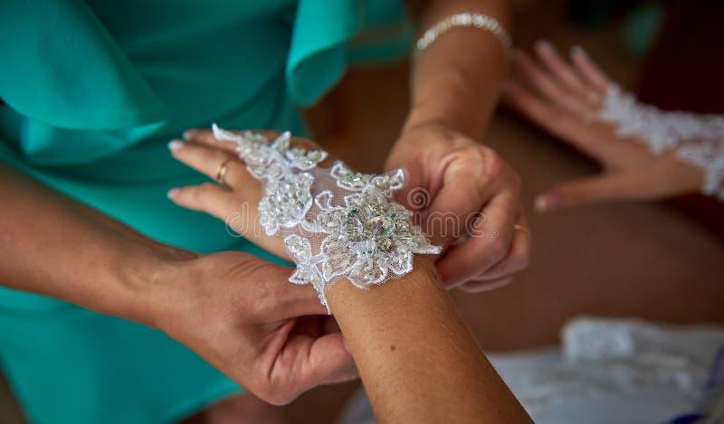 Dressing bride for wedding stock photo