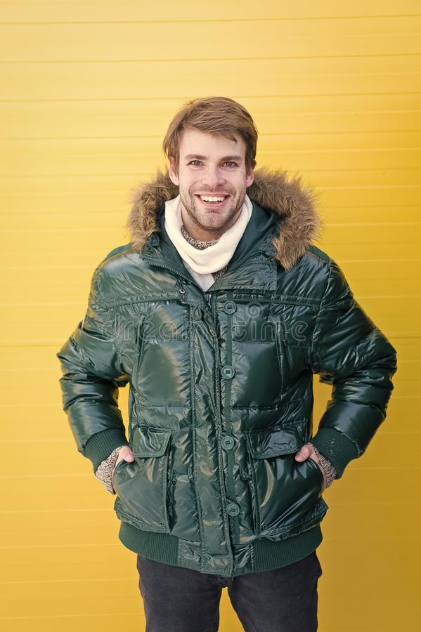 Dressing properly. Fashionable man in cold weather style. Handsome man wearing hooded coat. Fashion model enjoying. Warmth and comfort. Casual fashion coat for stock photography