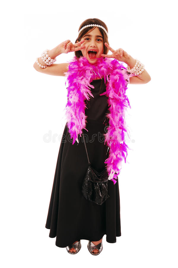 Dressing up. Portrait of young girl dressing up in fancy dress royalty free stock images