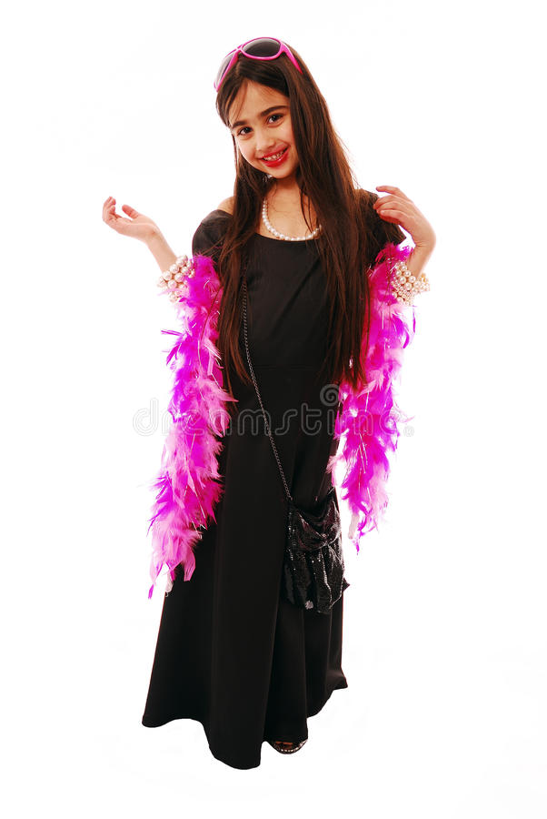 Dressing up. Portrait of young girl dressing up in fancy dress stock images
