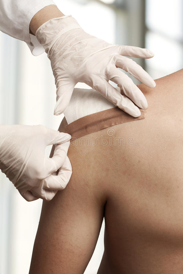 Dressing the wound royalty free stock images