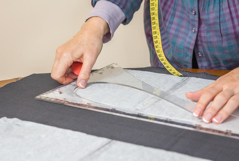 Dressmaker design tailor pattern on the table stock images