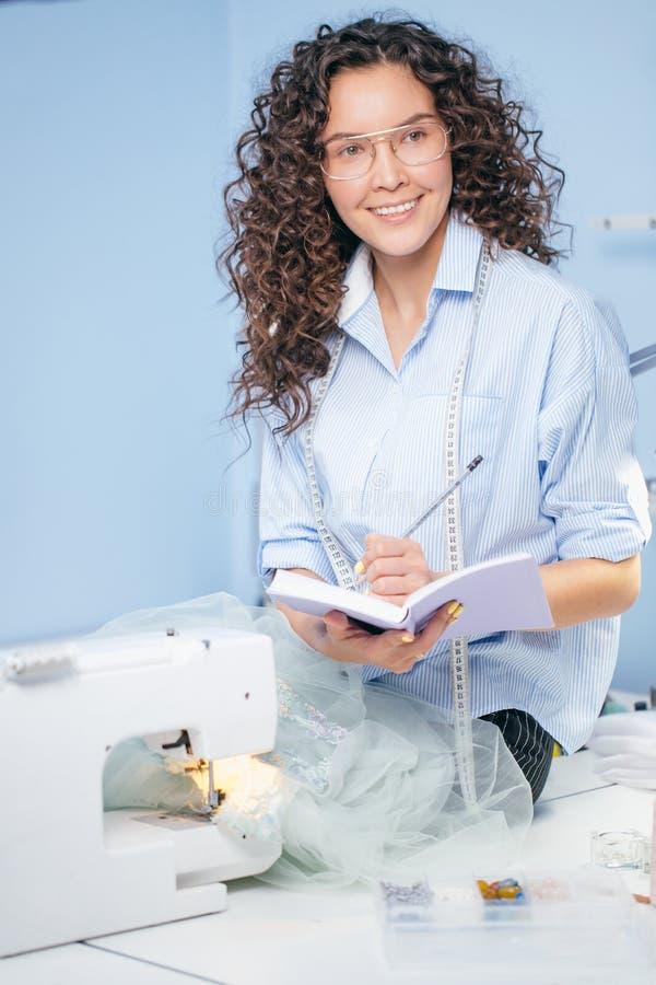 Dressmaker making up design of garment royalty free stock images