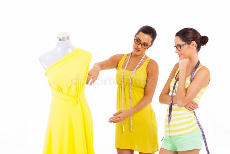 Dressmakers working together stock image