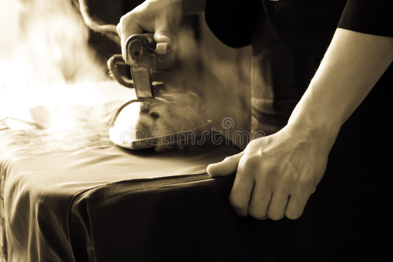 Dressmaking With Iron Royalty Free Stock Photos